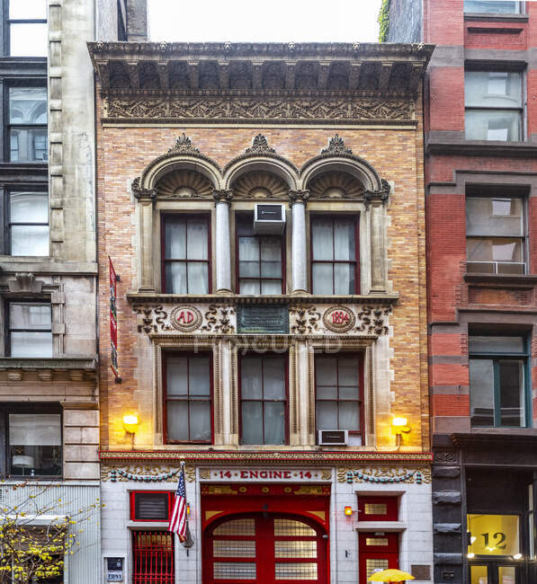 Fire Station 14 with flags and historic facade, Manhattan; New York City, New York, United States of America — Stock Photo