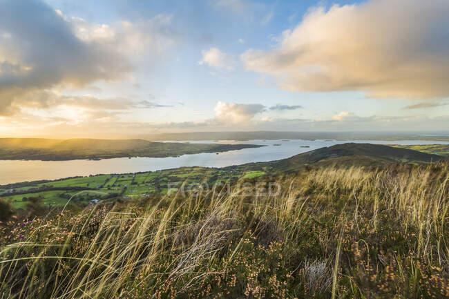 Landscape view of Irish hill and countryside with a lake in the distance; Tauntinna, County Tipperary, Ireland — Stock Photo