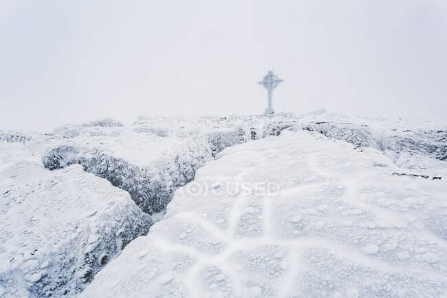Frozen ice formations on the summit of Galtymor mountain with a celtic cross in winter, Galty Mountains; County Tipperary, Ireland — Stock Photo