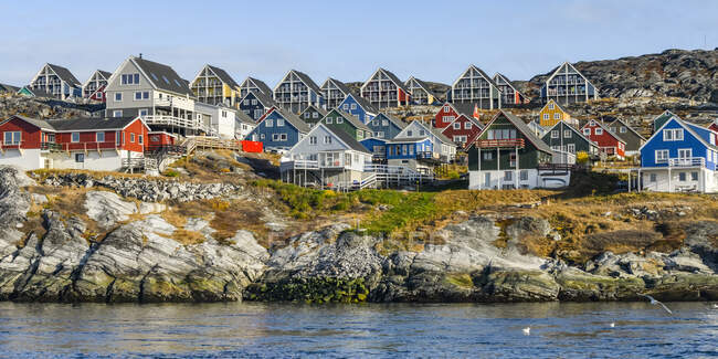Colourful houses along the rocky shore of Nuuk; Nuuk, Sermersooq, Greenland — Stock Photo