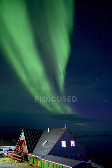Northern Lights over the coastline and houses of Nuuk, Greenland; Nuuk, Sermersooq, Greenland — Foto stock