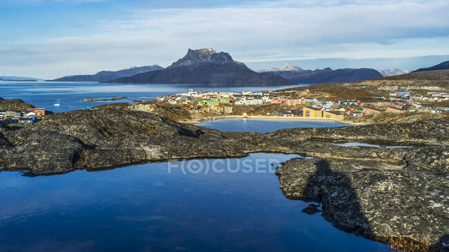 A view of the rugged coastline of Sermersooq and houses in Nuuk; Nuuk, Sermersooq, Greenland — Stock Photo