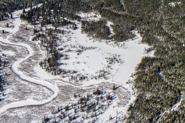 Frozen river winding through a snowy landscape; Quebec, Canada — Stock Photo