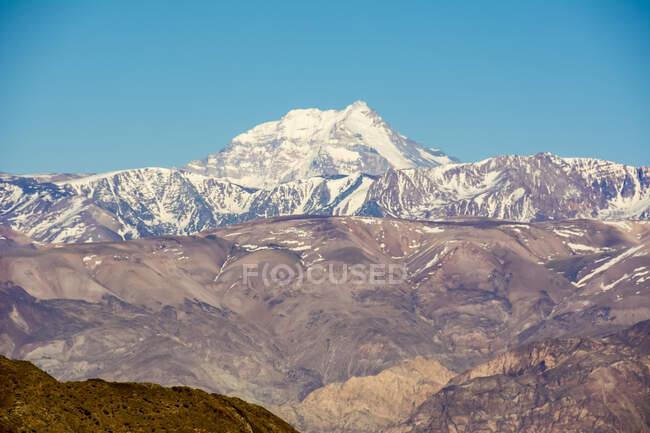 Mount Aconcagua dominating the landscape over the foothills; Mendoza, Mendoza, Argentina — Stock Photo