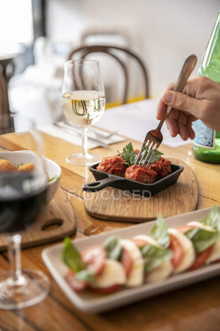Eating meatballs in a restaurant; Melbourne, Victoria, Australia — Stock Photo