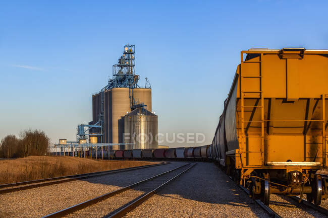 Hopper Wagon on a train approaching a grain storage facility; Alberta, Canada — Stock Photo
