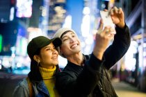 Asian tourist take a selfie in Time Square — Stock Photo
