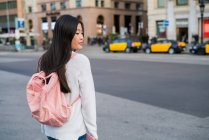 Young Chinese woman on the streets of Barcelona cap — Stock Photo