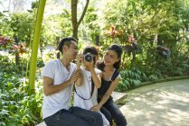Family taking a break while exploring Gardens by the Bay, Singapore — Stock Photo
