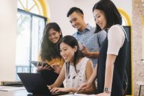 Young asian people working in creative modern office — Stock Photo