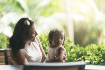 Portrait of young mother with asian daughter — Stock Photo