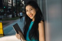 Young adult business woman with laptop outdoors — Stock Photo