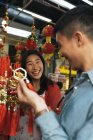 Young asian couple spending time together in shop — Stock Photo