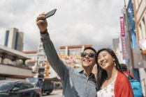 Asian Chinese Couple taking selfie at Chinatown — Stock Photo