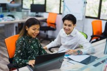 Young asian business people working in modern office — Stock Photo