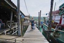 Young woman exploring Ban Ao Yai village in Thailand — Stock Photo