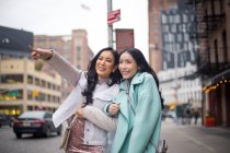 Two beautiful asian women together at new york, usa — Stock Photo