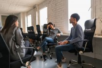 Chinese Entrepreneurs having a discussion in office — Stock Photo