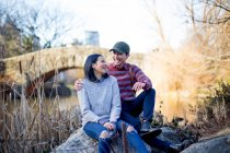 Young asian couple of tourists relaxing in central park , New York, USA — Stock Photo
