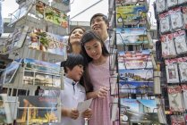 Happy young asian family together at street market — Stock Photo