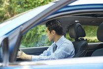 Young male driver in the car, side view — Stock Photo