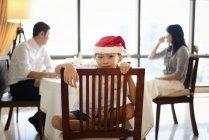 Happy asian boy in santa hat celebrating Christmas at home — Stock Photo
