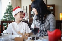 Happy asian mother and son celebrating Christmas together at home — Stock Photo