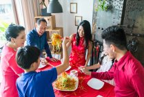 Happy asian family together eating at home — Stock Photo