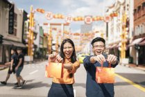 Young asian couple celebrating Chinese New Year together in chinatown — Stock Photo