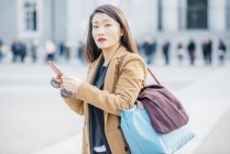 Chinese woman with smartphone in Madrid, Spain — Stock Photo