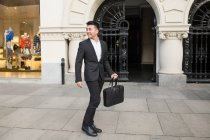 Chinese businessman walking down the street in Madrid, Spain — Stock Photo