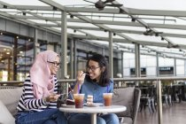 Two Women Enjoying Their Time  At A Cafe — Stock Photo