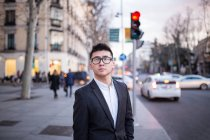 Portrait of a smart Chinese businessman standing in Serrano street in Madrid, Spain — Stock Photo