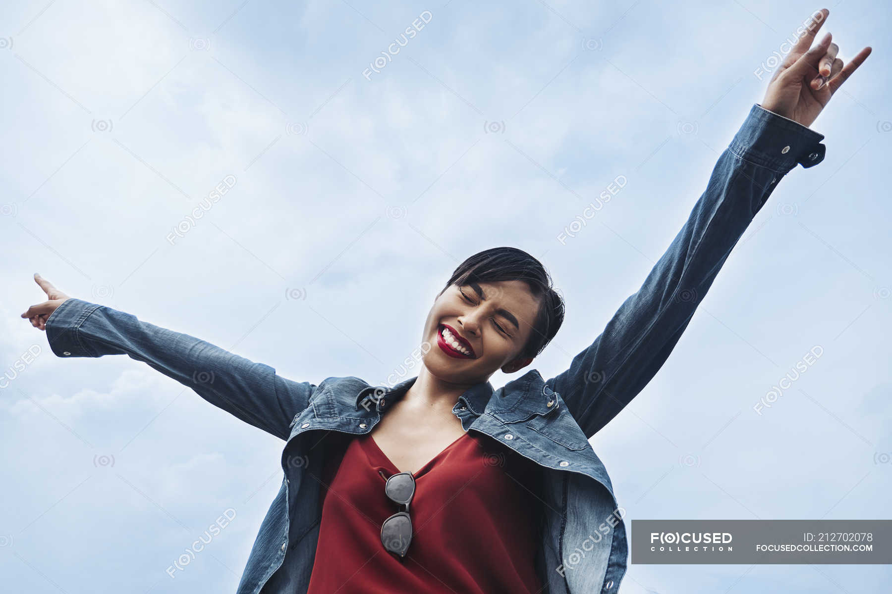 A Happy And Cheerful Young Malay Lady In Singapore Throwing Her Hands In The Air And Smiling Swinging Hands Arms Up Stock Photo 212702078
