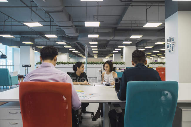 Young asian business people on meeting  in modern office — Stock Photo