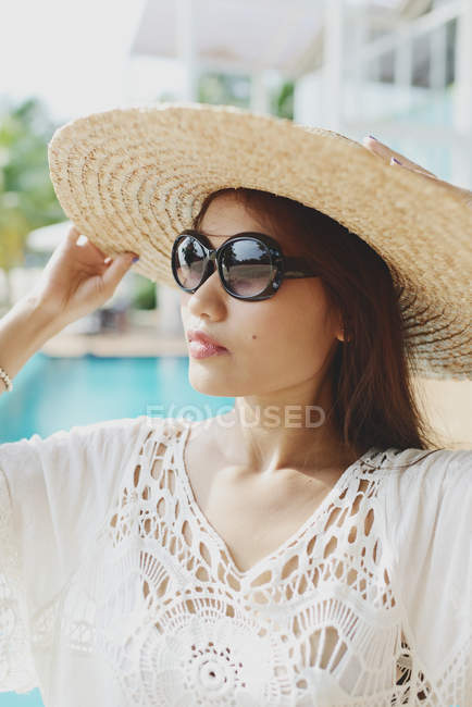 Portrait of beautiful young asian woman in straw hat — Stock Photo