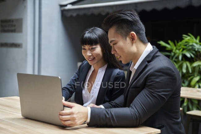 Two business partners discussing work in office — Stock Photo