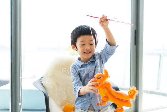 Cute asian boy playing with toys — Stock Photo