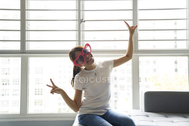 Young woman having fun with her fun glasses — Stock Photo