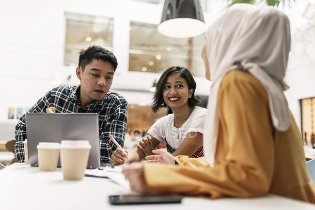 Young multicultural business people at meeting in modern office — Stock Photo