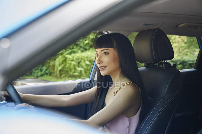Young beautiful asian female driver — Stock Photo