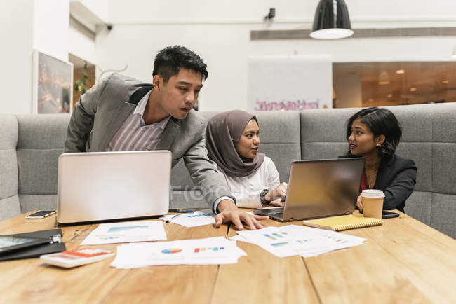Young multicultural business people working in modern office — Stock Photo