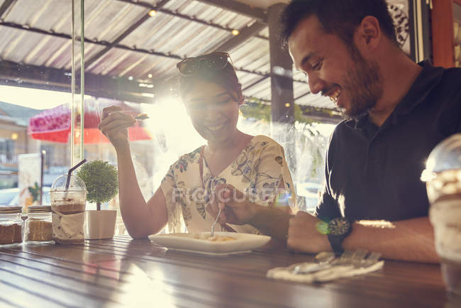 Young couple enjoying the food in a cafe — Stock Photo