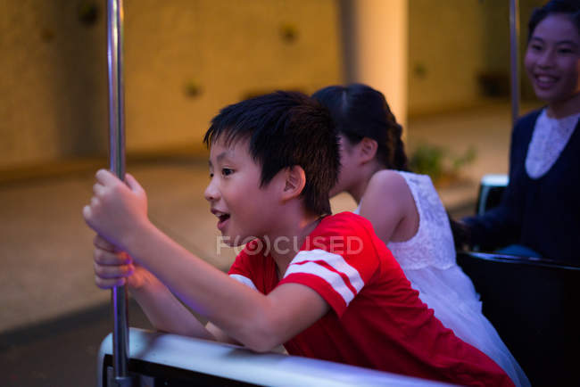 Happy asian family spending time together in amusement park at christmas — Stock Photo