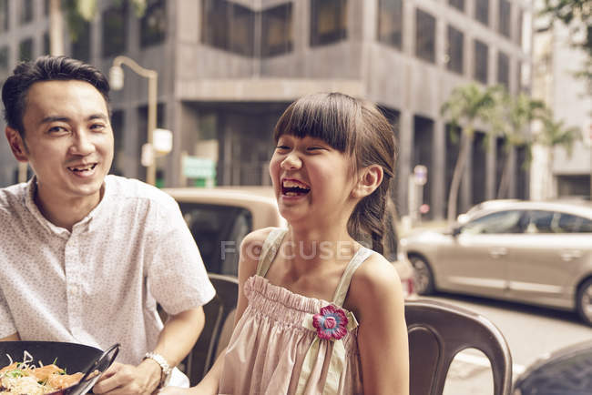 Young happy asian family, father laughing with girl — Stock Photo