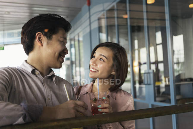 Young asian couple spending time together with drink — Stock Photo