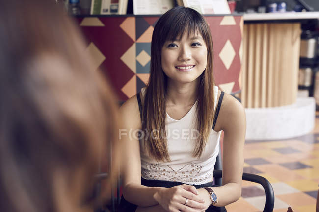 Young cute asian woman sitting on chair — Stock Photo