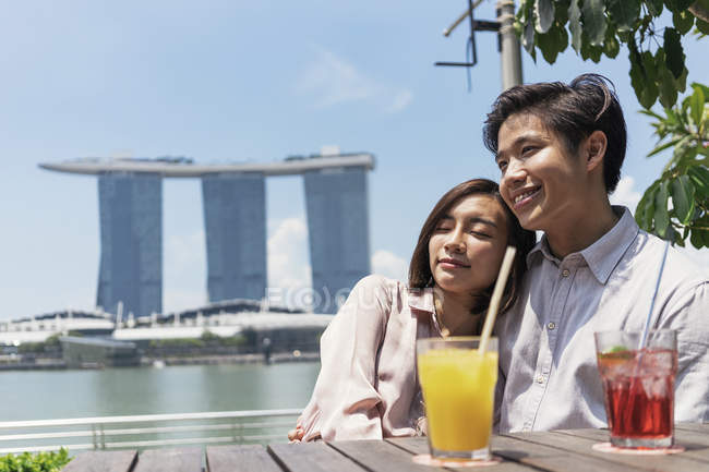 Young asian couple spending time together with drinks — Stock Photo