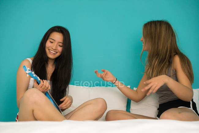 Chinese woman with her friend having fun — Stock Photo