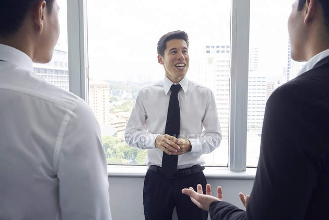 Handsome asian businessmen at meeting in office — Stock Photo